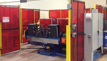 TRC Dual Robotic Arc Welding Cell with Servo Tool, Indexer and Robotic Eject
