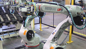 Motoman UP6 Robots Programmed For Automatic Part Handling Into And Out Of Welders And Part Load Magazines